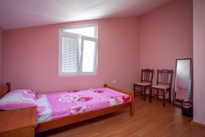 Кровать или кровати в номере Apartment Kandic