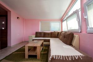 Гостиная зона в Apartment Kandic