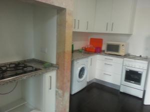 A kitchen or kitchenette at Lisbon Gambori Hostel