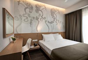 A bed or beds in a room at Kriti Hotel