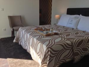 A bed or beds in a room at Casa Dona Maria Luiza