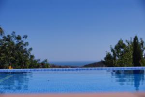 The swimming pool at or near Casa Mocho Branco