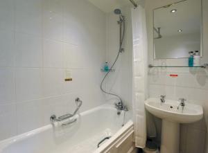 A bathroom at Royal Hotel by Greene King Inns