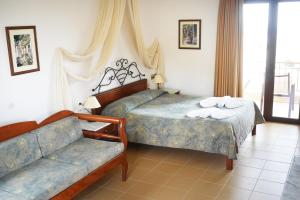 A bed or beds in a room at Areti Aparthotel