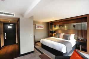 A bed or beds in a room at Crowne Plaza Gerrards Cross, an IHG Hotel