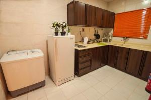A cozinha ou cozinha compacta de City Suites