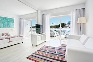 A seating area at Grupotel Ibiza Beach Resort - Adults Only