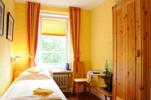 Ein Bett oder Betten in einem Zimmer der Unterkunft Hotel zur alten Stadtmauer