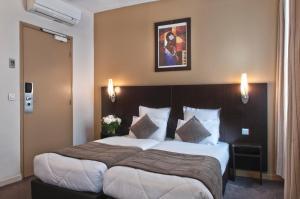 Un ou plusieurs lits dans un hébergement de l'établissement Les Hauts de Passy - Trocadero Eiffel