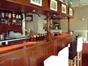 The lounge or bar area at Bath House Hotel