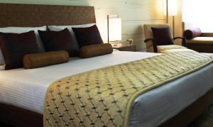 A bed or beds in a room at Vivanta Goa, Panaji