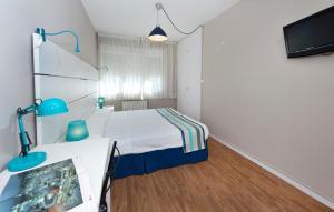 A bed or beds in a room at Estudios Aránzazu