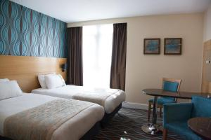 A bed or beds in a room at Holiday Inn Birmingham City, an IHG Hotel