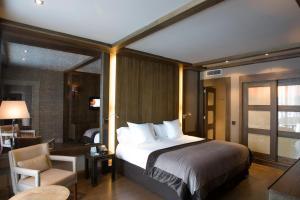 Cama o camas de una habitación en Hotel Val de Neu G.L.