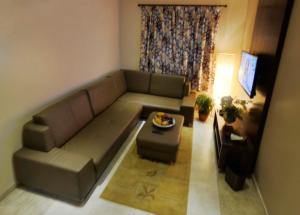 Uma área de estar em City Suites