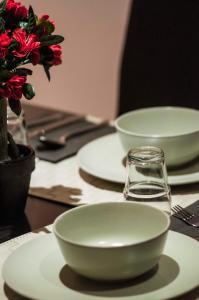 Um restaurante ou outro lugar para comer em City Suites