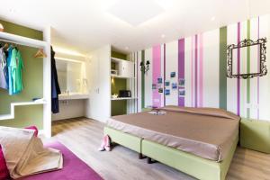 Ein Bett oder Betten in einem Zimmer der Unterkunft Roma Camping In Town