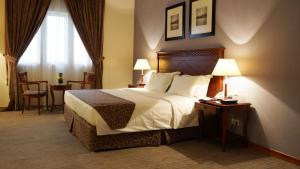 Cama ou camas em um quarto em Executives Hotel - Olaya