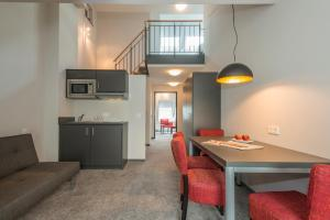 A kitchen or kitchenette at The Stay.residence