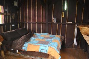 A bed or beds in a room at Natty Tropical Valley