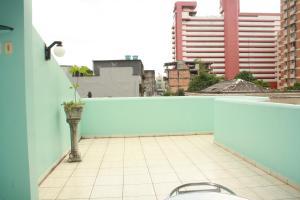 Un balcón o terraza de Hotel Magnifico