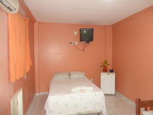 Cama o camas de una habitación en Hotel Magnifico