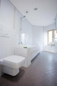Ванная комната в Hotel Babilonas
