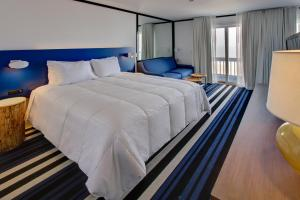 A bed or beds in a room at Montauk Blue Hotel