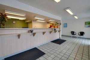 The lobby or reception area at Motel 6-Kissimmee, FL - Orlando