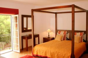 A bed or beds in a room at Casa Pinha