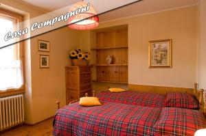 A bed or beds in a room at Casa Compagnoni