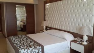 A bed or beds in a room at Esila Hotel