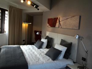 Cama o camas de una habitación en Hotel Lastres Miramar