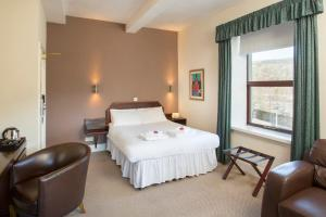 A bed or beds in a room at The Imperial Crown Hotel