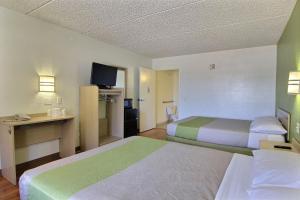 Krevet ili kreveti u jedinici u okviru objekta Motel 6 Austin, TX - Central Downtown UT