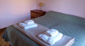 A bed or beds in a room at Cabañas El Puesto Sur