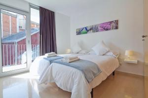 Cama o camas de una habitación en Charmsuites Paralel