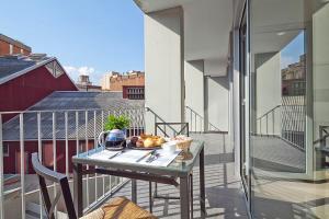 Un balcón o terraza de Charmsuites Paralel
