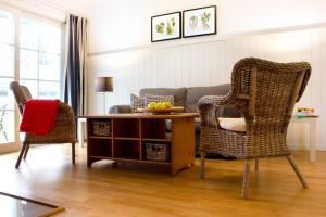 Ein Sitzbereich in der Unterkunft Louisenhof Ferienapartments und Wellness