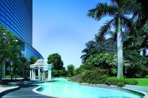 The swimming pool at or near Shangri-La Guangzhou (Welcome minibar is provided upon arrival)