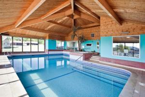 The swimming pool at or near Waveney Inn