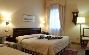 Кровать или кровати в номере Villa Crispi
