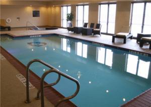 The swimming pool at or near Hampton Inn & Suites Bastrop