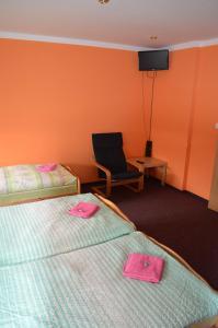 Кровать или кровати в номере Motorest Penzion na Bojišti