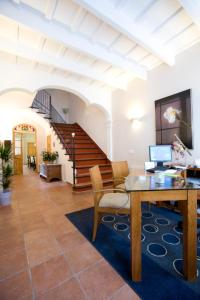 The lobby or reception area at Hotel Es Mercadal