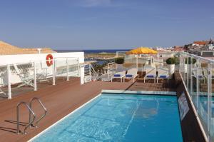 The swimming pool at or near Hotel Marina Rio