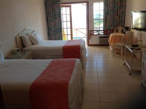 A bed or beds in a room at Unique Village