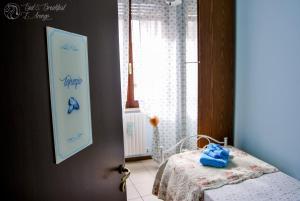 Letto o letti in una camera di Bed & Breakfast L'Arengo