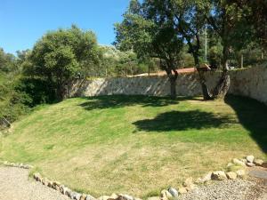 A garden outside Hotel Giardino Corte Rubja