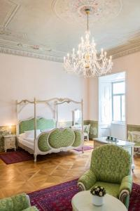 A bed or beds in a room at Zamek Hradek u Susice